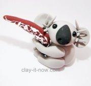 cute koala hugging a boomerang