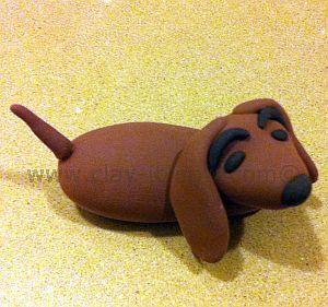 dachshund figurine, short-legged long-bodied dog breed, dachshund