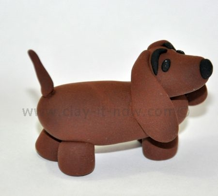 dachshund figurine, short-legged long-bodied dog breed, dachshund