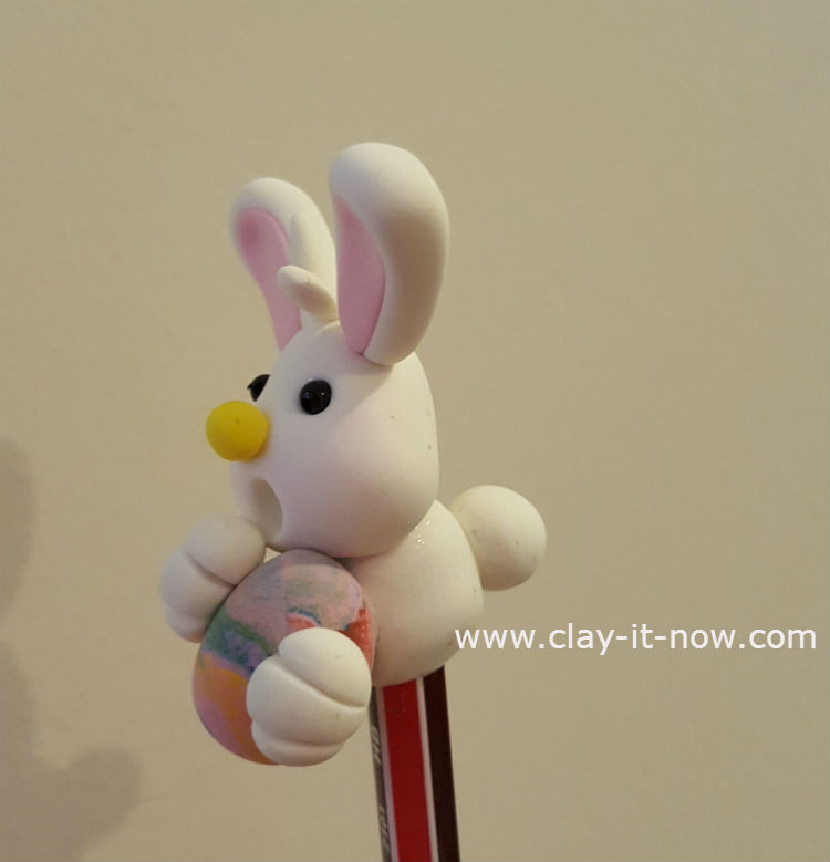 Easter Bunny Pencil Topper Hugging A Multi Colored Egg