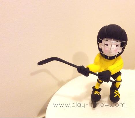 ice hockey boy figurine