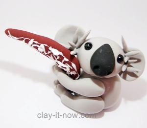 cute koala with boomerang figurine, koala clay