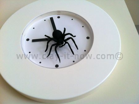 friendly spider, spider clay, spider on the clock, clay for home decoration