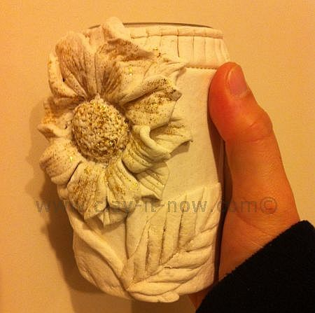 sunflower creation on recycled jam bottle, sunflower clay