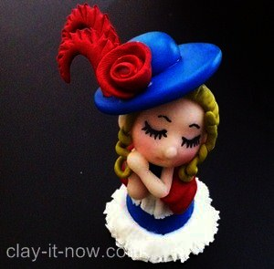 cute mini figurine wearing Victorian style dress
