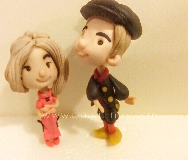Cute couple figurine wearing Qi Pao and Dutch traditional dress